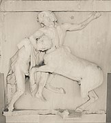 Sculpture of a man fighting a centaur.