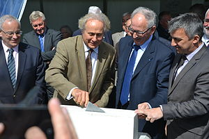 Airborne Museum (Sainte-Mère-Église) - Michael Reagan. third from left, helped lay the first stone of a new conference center, May 19, 2015