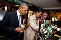 Michelle Obama pours a pint of stout.jpg