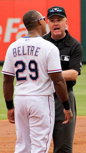 Mike Everitt (baseball) - Everitt and Adrián Beltré playfully argue during a 2014 game