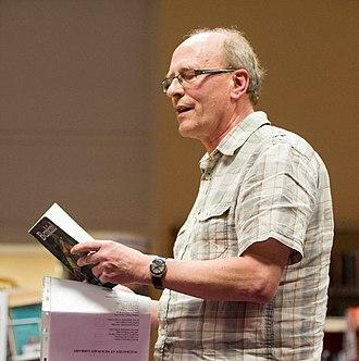 Mike Jenkins (poet) - Jenkins performing at Rhydyfelin Library in 2014