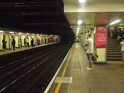Mile End tube stn eastbound District look west2 2012.JPG