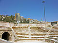 Modern Amman buildings from stage at Roman theater.jpg
