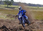 A rider cornering during a motocross race in Australia