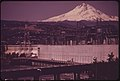 Mt. Hood Rises behind the Dalles Dam on the Columbia River This Dam Has Two Fish Ladders and a Powerhouse Collection System 05-1973 (4271624267).jpg