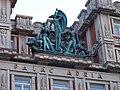 Národní, palác Adria, sochy na střeše.jpg