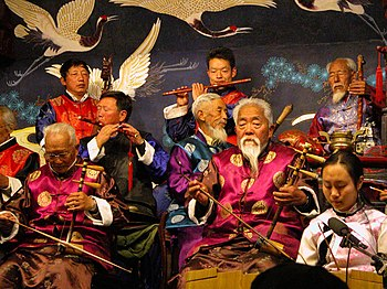Traditional Chinese music played by aging Naxi...