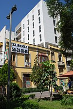 new building under construction behind the facade of the former structure on Genova Street, Colonia Juarez, Mexico City