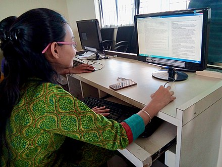 A student doing proof reading during her project at New Law College (Pune) India New Law College-Wikisource2.jpg