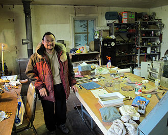 Grise Fiord - Looty Pijamini in his shop where he creates his carvings.