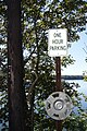 One hour parking sign and hubcap, Damariscotta, Maine - 20130919.JPG