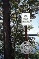 One hour parking sign and hubcap, Damariscotta, Maine - 20130919.JPG
