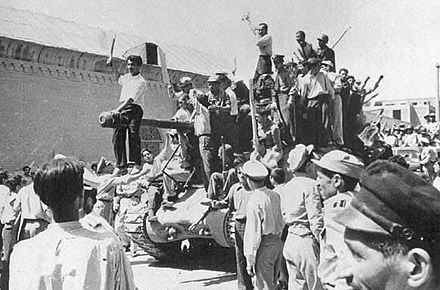 Tehran men celebrating the 1953 Iranian coup d'état Operationajax.jpg