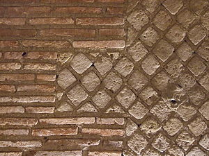 Opus mixtum - Example of Opus mixtum comprising Opus reticulatum edged with Opus latericium in the Roman theatre, Naples, Italy.