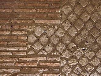 Opus mixtum - Example of Opus mixtum comprising Opus reticulatum edged with Opus latericium in the Roman theatre, Naples, Italy.