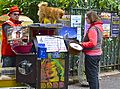 Organ grinder with pets, Paris May 2014.jpg