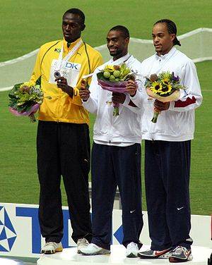 Usain Bolt - Bolt (left) on the podium with his silver medal from the 200 m race in Osaka (2007)