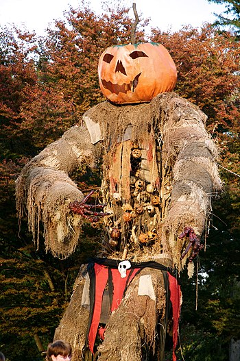 Pumpkin-headed scarecrow monster