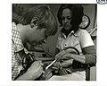 PHS dentist and a dental assistant work on mouth of a patient.jpg