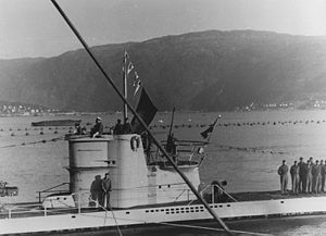 U-255 at Narvik flying four victory pennants and the flag of the merchant ship SS Paulus Potter after the attack on the ships of Convoy PQ 17