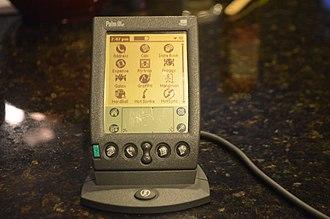 Palm IIIe - A Palm IIIe sitting in its HotSync cradle.