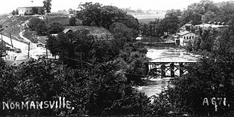 Normansville, New York - Photo of Normansville, circa 1900, school house (Bethlehem side) top left, ice house (Albany side) top right.