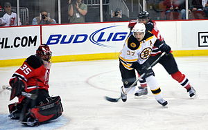 Patrice Bergeron - Bergeron skates towards the net during a game against the New Jersey Devils in February 2009.