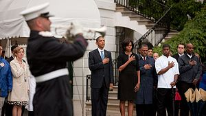 President Barack Obama, First Lady Michelle Obama and White House staff observe a moment of silence on September 11, 2009.