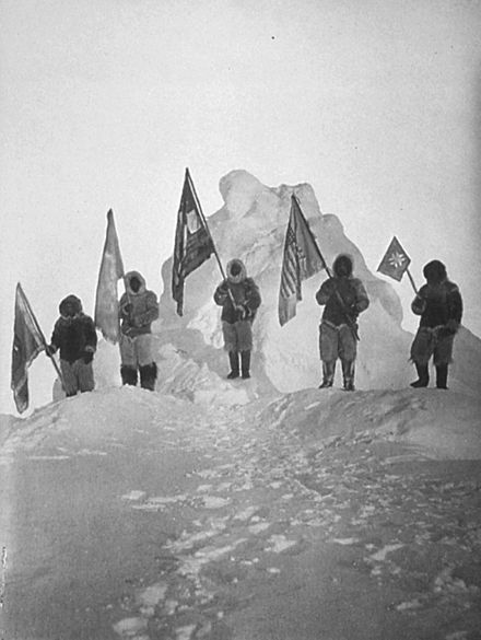 Peary's sledge party at what they claimed was the North Pole, 1909. From left: Ooqueah, Ootah, Henson, Egingwah, and Seeglo. Peary Sledge Party and Flags at the Pole.jpg