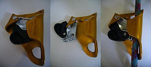 Petzl Croll - A Petzl Croll with the gate closed, open and with a rope locked in place.