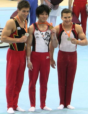 Longines Prize for Elegance - Philipp Boy (left; 2010) and Kohei Uchimura (center; 2011, 2013, 2014) with medals from the 2010 World Championships