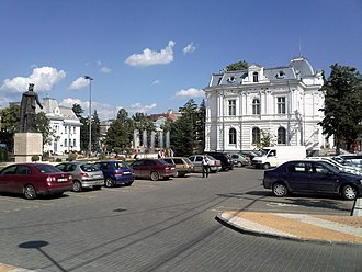 Pitești - View of the central square with the Art Gallery on the right side of the picture and the City Hall building on the left side.