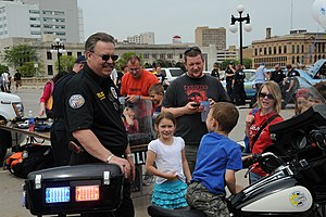 Community policing - Police officers interact with civilians in Des Moines, Iowa during Police Week 2010