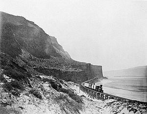 "Oregon Steam Navigation Company - The Dalles-Celilo portage railroad in 1867 looking west towards ""Cape Horn""."
