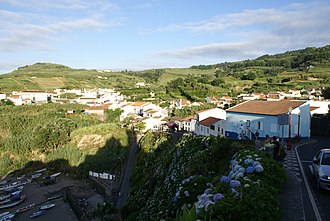 Porto Formoso - A partial view of the built-up area of the village of Praia Formoso, looking over into the fishing port/beach