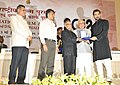 Pranab Mukherjee presenting the Swarna Kamal Award for Best Popular Film Providing Wholesome Entertainment Vicky Donor (Hindi), to Actor John Abraham, on behalf of the Producer Eros International, J A Entertainment.jpg