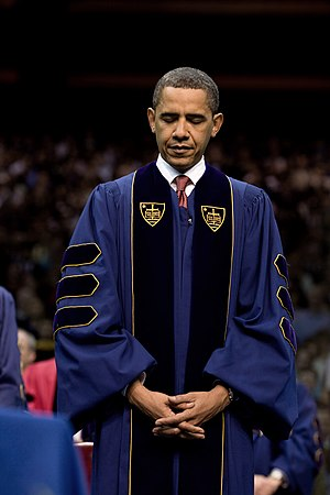 President Barack Obama bows his head during th...