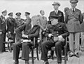 President Roosevelt and Winston Churchill seated on the quarterdeck of HMS PRINCE OF WALES for a Sunday service during the Atlantic Conference, 10 August 1941. A4815.jpg
