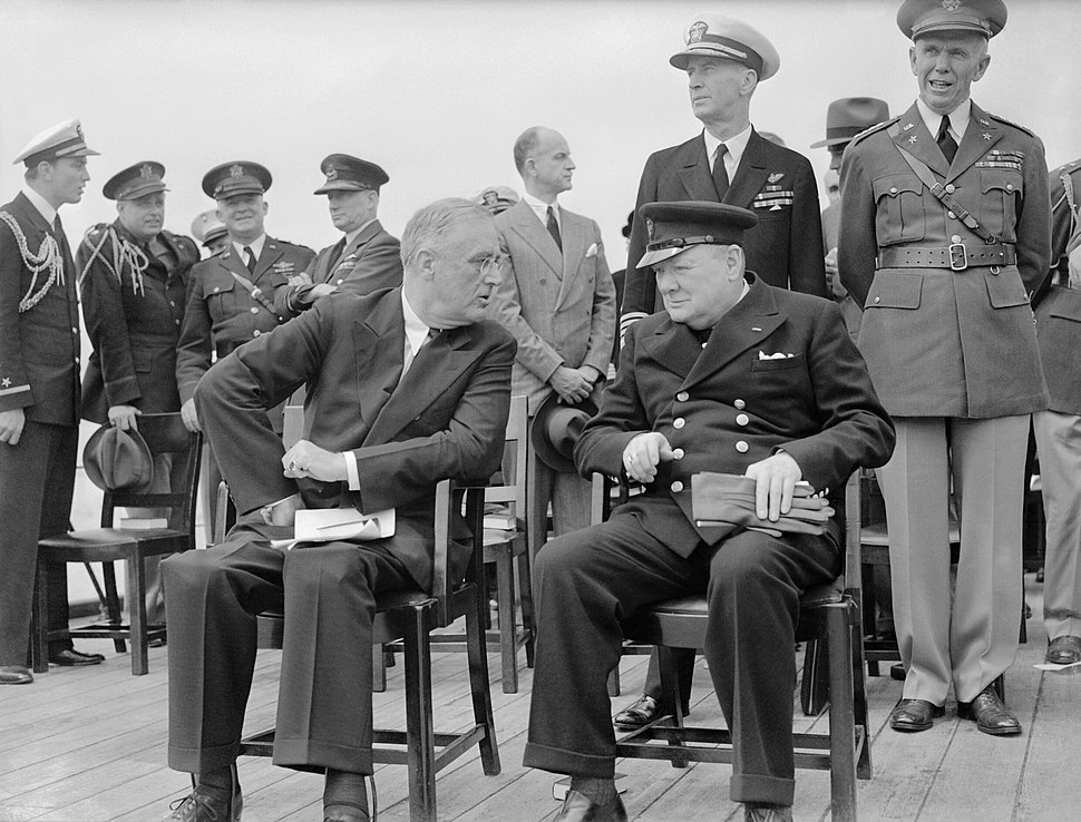 President Roosevelt and Winston Churchill seated on the quarterdeck of HMS PRINCE OF WALES for a Sunday service during the Atlantic Conference, 10 August 1941. A4815