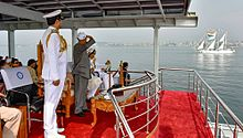 President Mukherjee standing and watching the ships pass