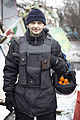 Protester with oranges in his helmet.jpg