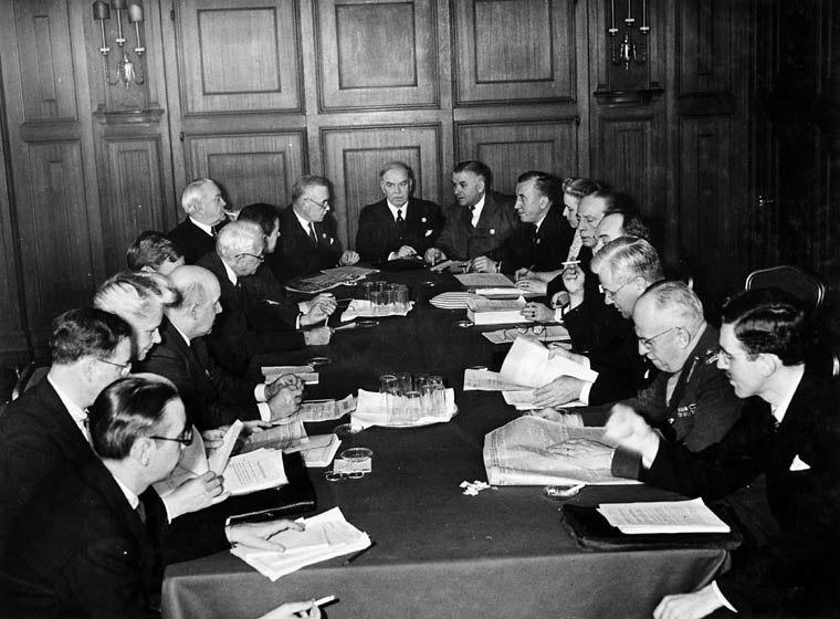 Pictured from Left to right: C.S. Ritchie, P.E. Renaud, Elizabeth MacCallum, Lucien Moraud, Escott Reid, W.F. Chipman, Lester Pearson, J.H. King, Louis St. Laurent, Rt. Hon. W.L. Mackenzie King, Gordon Graydon, M.J. Coldwell, Cora Casselman, Jean Desy, Hume Wrong, Louis Rasminsky, L.D. Wilgress, M.A. Pope, R. Chaput