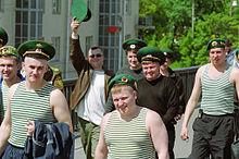 50e875f5 Former servicemen wear green telnyashkas during Border Guard's Day  celebration in Russia.