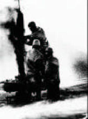 Red Adair - Adair fighting an oil field fire in the Elk Hills Oil Field on October 27, 1977