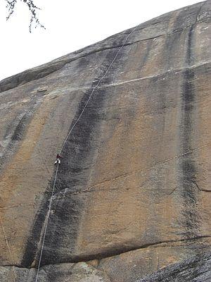 Ron Kauk - Ron Kauk top roping Bachar-Yerian route (5.11c) on Medlicott Dome, Right Side.  Tuolumne Meadows.