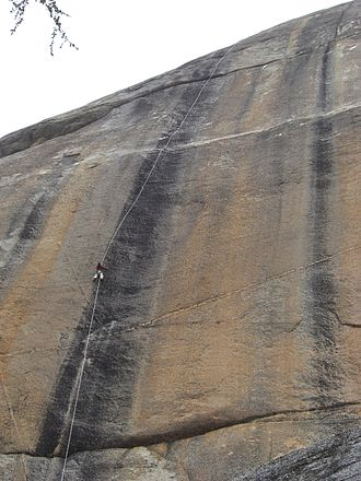 Ron Kauk - Ron Kauk top roping Bachar-Yerian route (5.11c) on Medlicott Dome, Right Side.  Tuolumne Meadows.