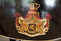 Royal coat of arms painted on carriage (40449924602).jpg