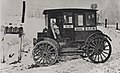 Rural carrier in automobile at mailboxes, c.1910.jpg