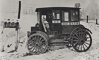 Rural Free Delivery - Rural carrier in an early electric vehicle, circa 1910