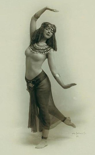 Sacred dance - Ruth St. Denis, in a dance pose inspired by the Egyptian goddess Isis. Photographed by Otto Sarony, 1910.